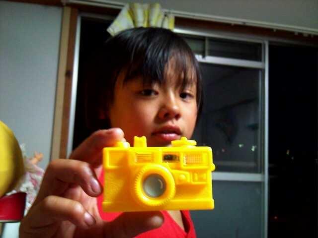 りんたと黄色のカメラ