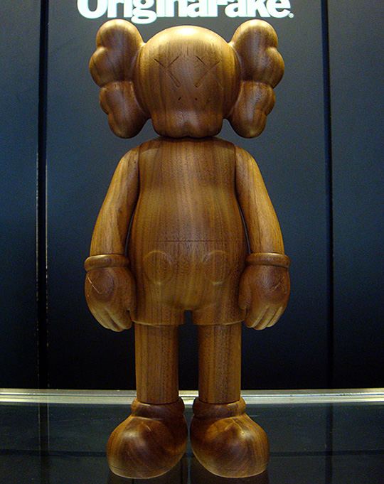 kaws-original-fake-karimoku-wood-companion-toy-2.jpg